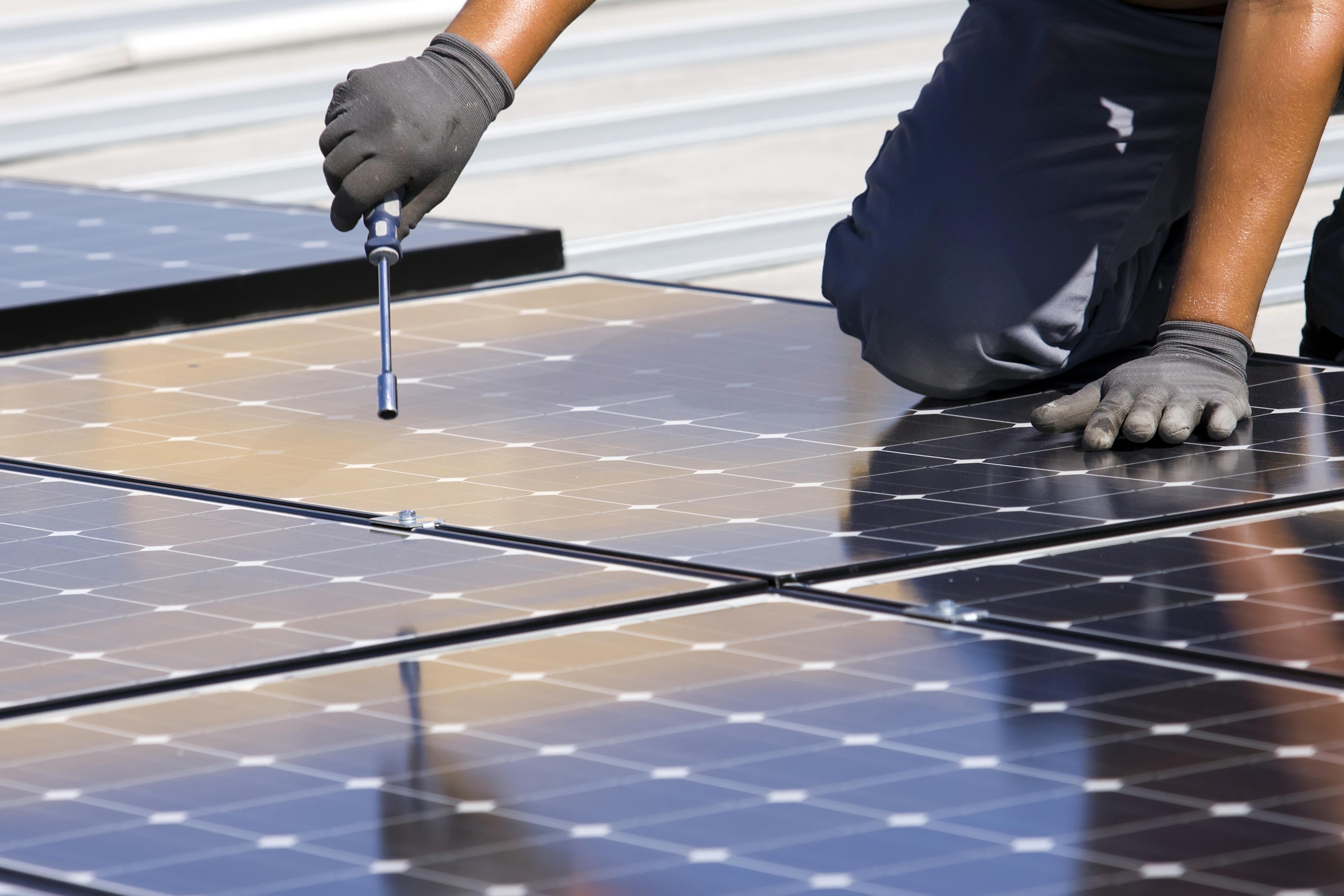Depositphotos_Servicing Solar Panels
